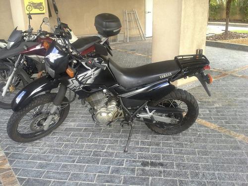 raridade xt 600 troco carro moto com dívida mesmo atrasadas