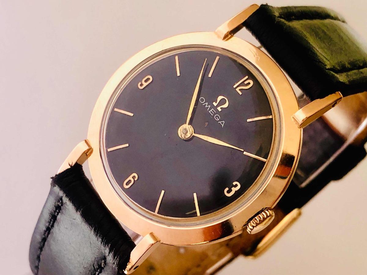ef2142c95a1 raro relógio de pulso suíço omega fundo negro ouro 18k 0750. Carregando  zoom.