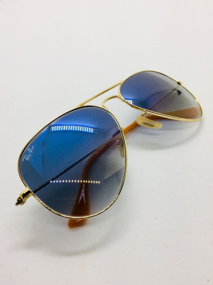 f89cb7a2176a8 ray ban aviador 3025 dourado com azul degrade original. Carregando zoom.