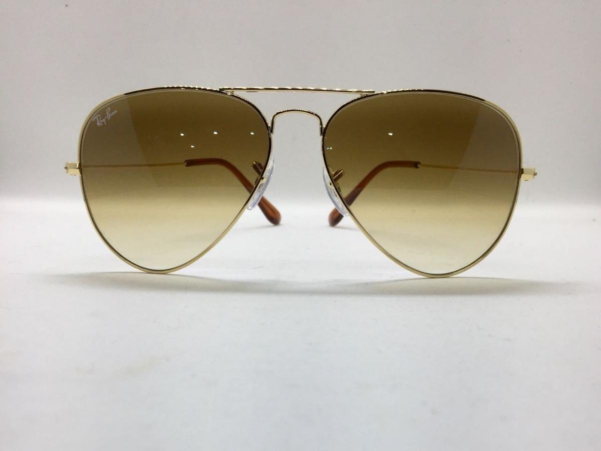 9a2831a432937 ray ban aviador 3025 dourado com marrom degrade original. Carregando zoom.