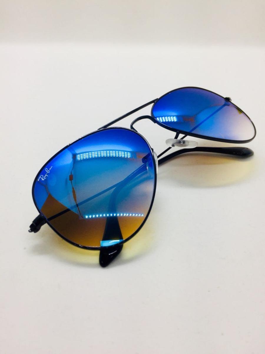 339619fbcd22a ray ban aviador 3025 preto com azul espelhado original. Carregando zoom.