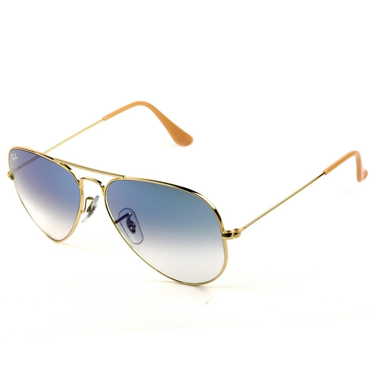 f42cb2263c006 ray ban aviador arm dourada lente azul degradê frete gratis. Carregando  zoom.