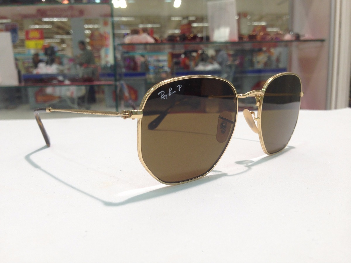 Óculos De Sol Ray Ban Hexagonal Rb 3548-n 001-57 - R  553,27 em ... bb910918da