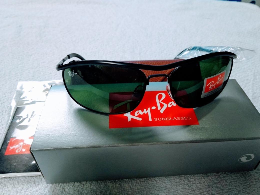 3e7f5758aedb2 rayban demolidor 8012 armação preta lente verde. Carregando zoom.