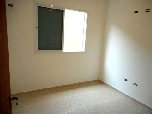 ref.: 1074 - casa em praia grande, no bairro canto do forte - 2 dormitórios