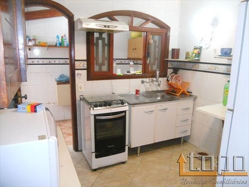 ref.: 1999 - casa em praia grande, no bairro canto do forte - 4 dormitórios