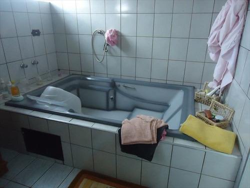 ref.: 20361900 - casa em praia grande, no bairro boqueirao - 3 dormitórios