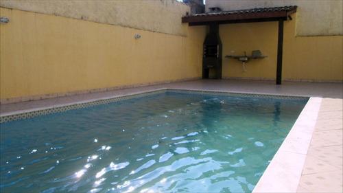 ref.: 500 - casa condomínio fechado em itanhaém, no bairro suarão - 2 dormitórios