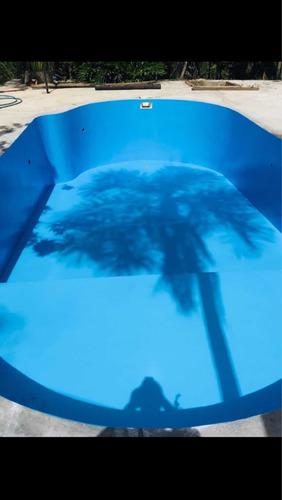 reforma de piscina de concreto e fibra .