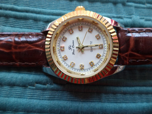 regale clasico reloj de mujer enchapado oro impecable