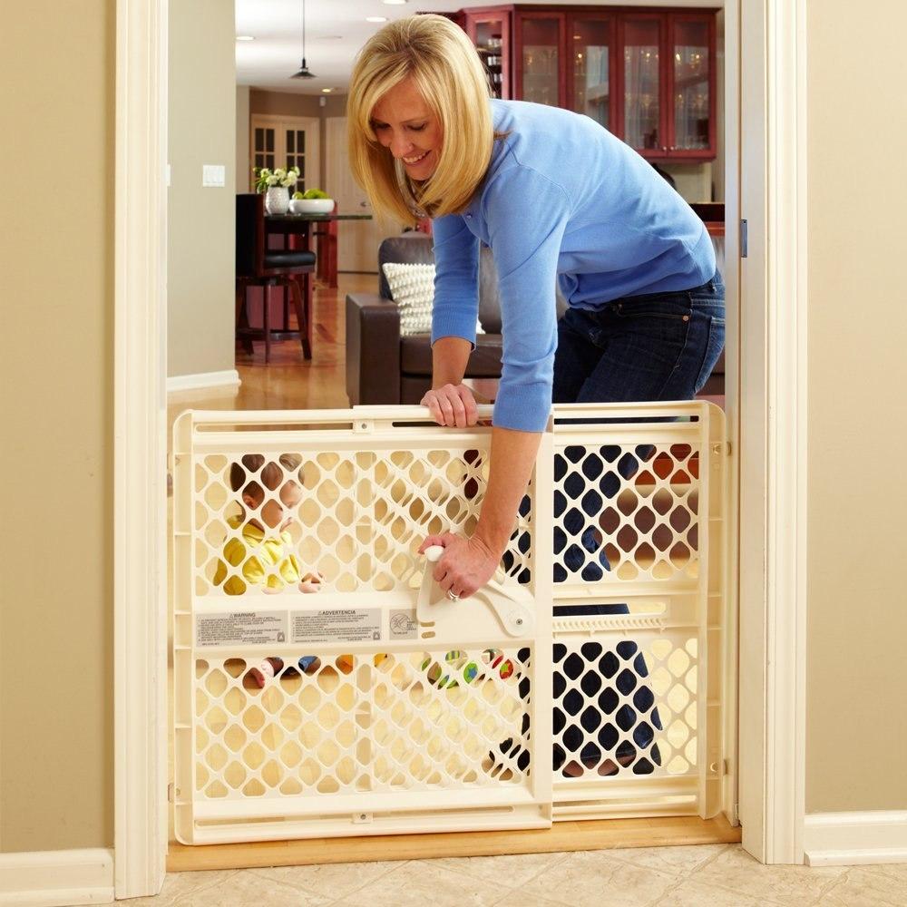 Reja puerta de seguridad north states para bebe o mascotas for Puerta seguridad perros