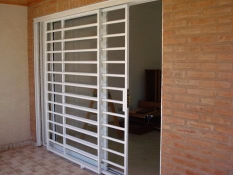 rejas para puerta balcon  doble hoja corrediza