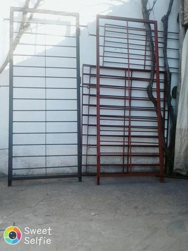 rejas , puertas de hierro  , portones , cercos perimetrales.