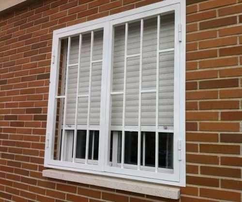 Rejas y ventanas modernas batientes corredizas en for Rejas de hierro precios