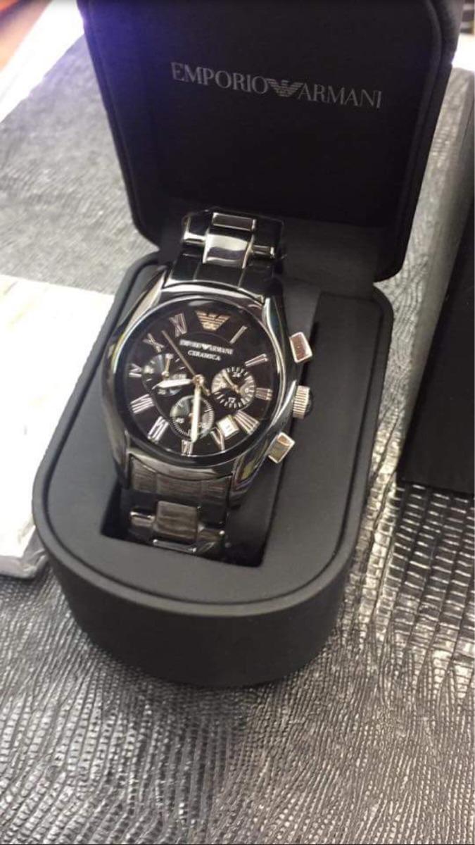 2893ed96f5b relógio armani ar1416 branco preto e dourado e preto e prata. Carregando  zoom.