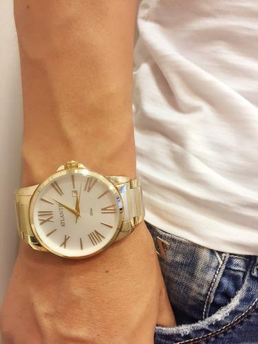 relógio atlantis marca original dourado preto aço homem soci