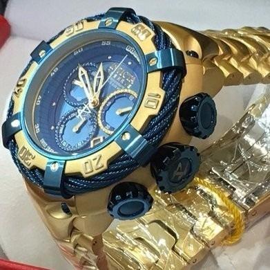 relogio bolt zeus dourado azul na caixa original