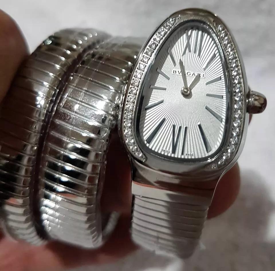 6bc1937e2e1 relogio bracelete serpente com pedras. Carregando zoom.