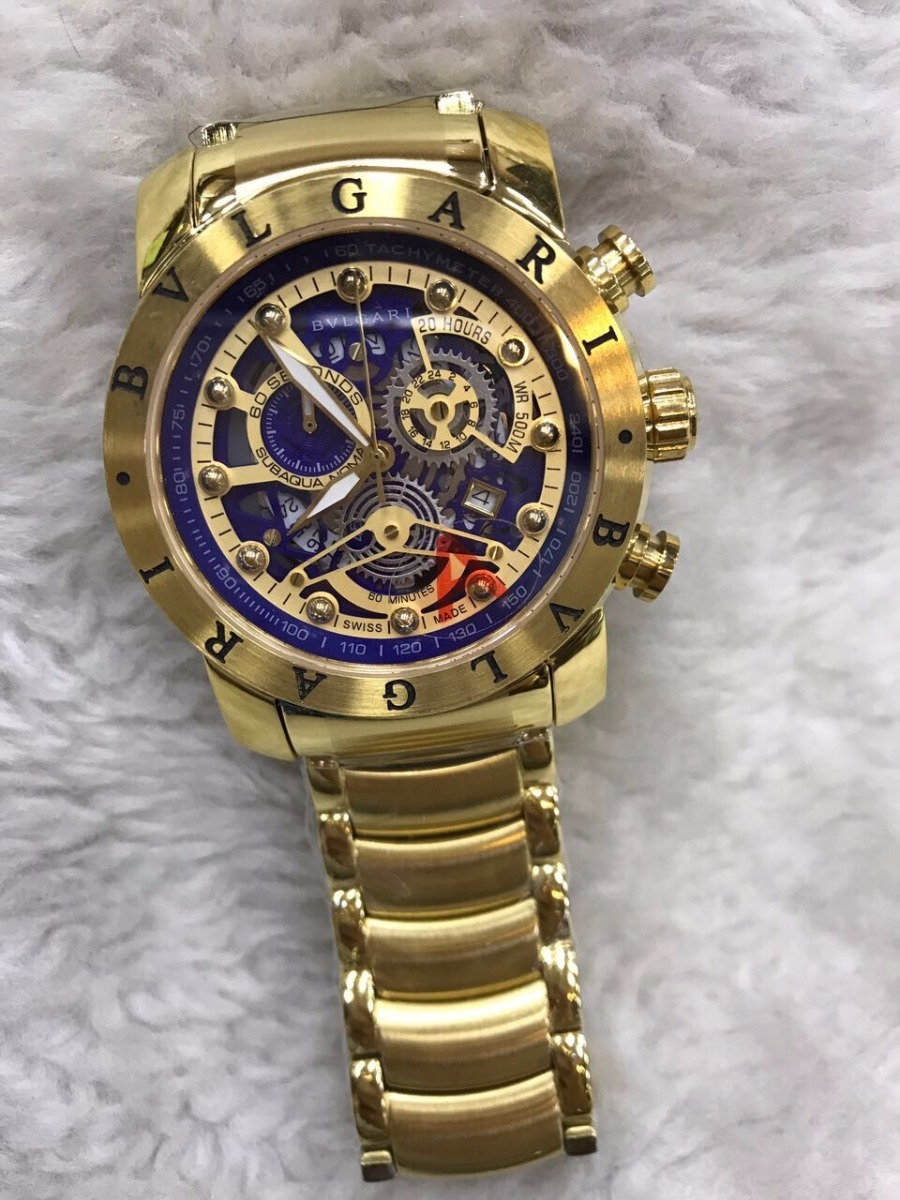 b89e859b2c5 Relógio Bvlgari Aço Eskeletum Dourado Fundo Azul + Brinde - R  499 ...