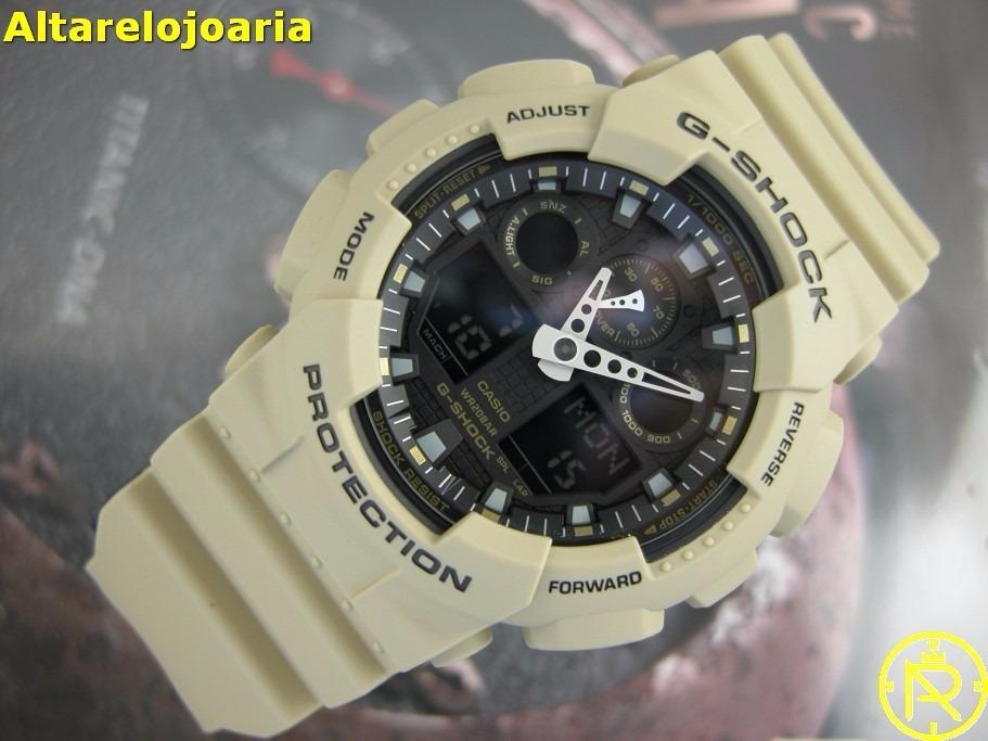 f1f1a3db0bd relógio casio g-shock bege fundo preto ga-100l-8a. Carregando zoom.