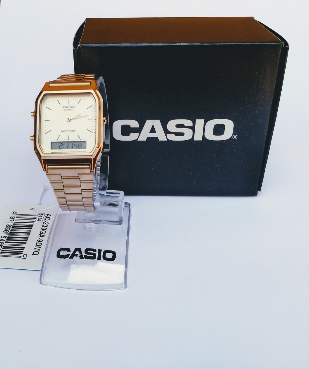 fe9ced7cb9c3 relógio casio retrô analógico-digital aq-230ga-9dmq dourado. Carregando  zoom.
