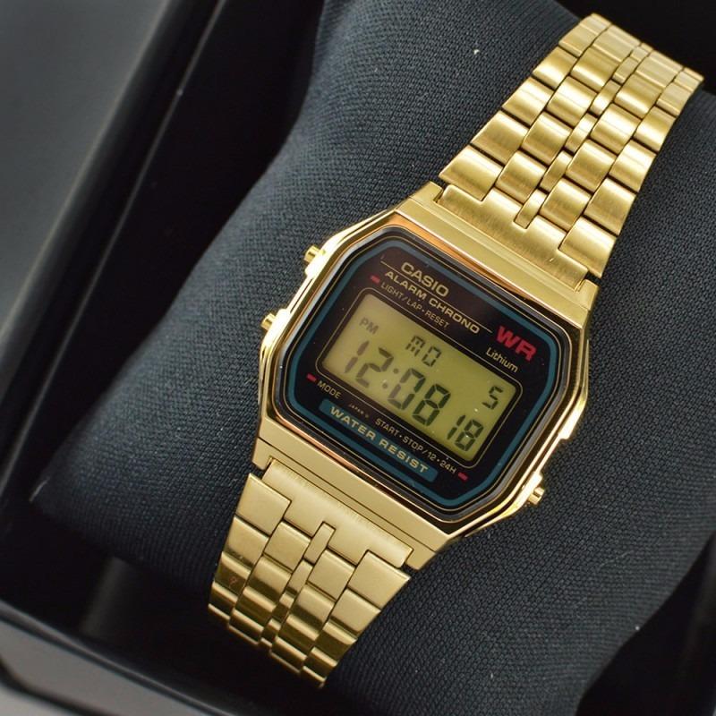 2ebd1d524682 relogio casio vintage unissex retro a159 dourado fundo preto. Carregando  zoom.