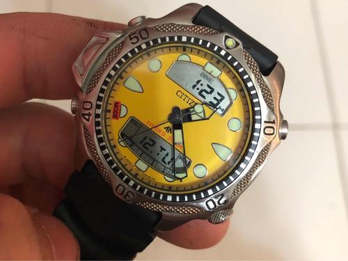 relógio citizen aqualand jp1010- c500 fundo amarelo