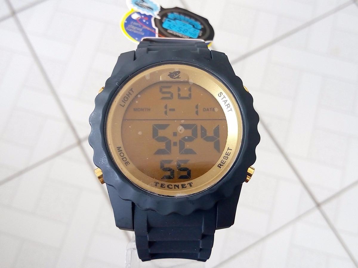 3b13e723672 relógio digital tecnet preto dourado prova d água original. Carregando zoom.