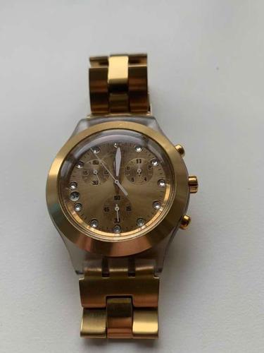 relógio dourado swatch