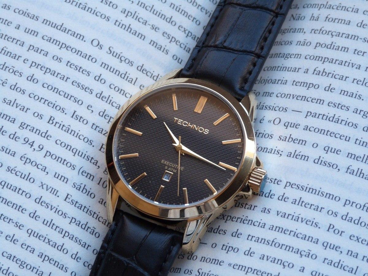 eb0f6af4c27 relógio dourado technos 2115k0x 2p pulseira de couro social. Carregando  zoom.