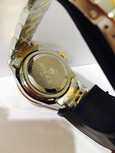relógio em aço misto gold mod sub com catraca preta e azul