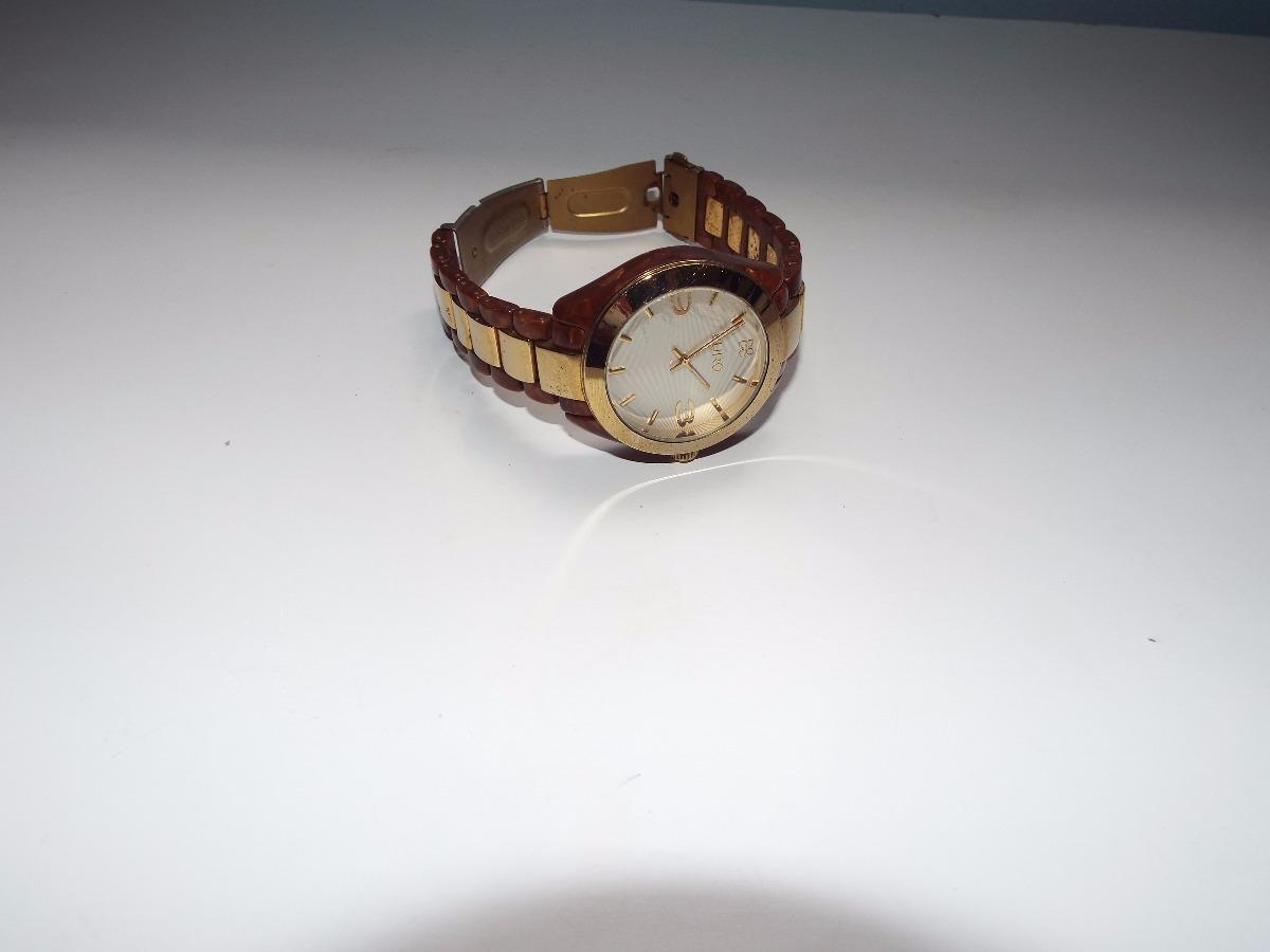 30f915017af relógio euro feminino dourado com defeito. Carregando zoom.