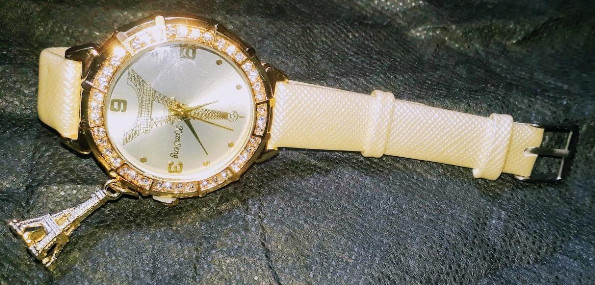 60c46d41fa5 relógio feminino c  pingente torre eiffel pulseira couro. Carregando zoom.