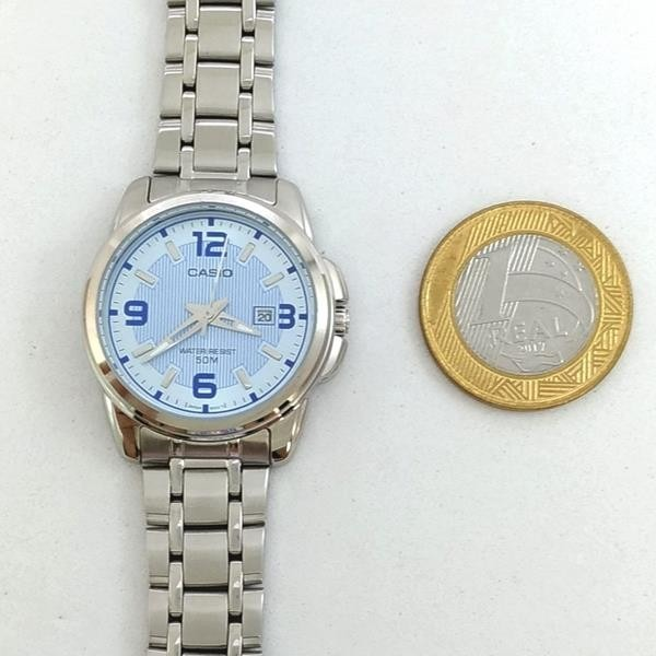 1bafc812733 Relógio Feminino Casio Ltp-1314d-2a Prateado Fundo Azul Wr50 - R ...