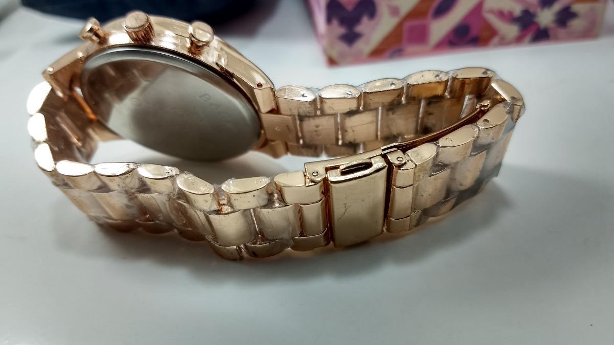 cf36ca467 relogio feminino dourado com acabamento em ouro rose. Carregando zoom.
