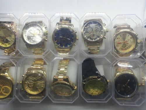 c5b8eb486d0 Relógio Feminino Dourado Fundo Azul Lindo Com Strass - R  99