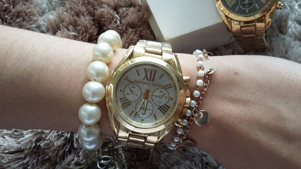 45f7d9e2e1b relógio feminino dourado grátis 2 lindas pulseiras. Carregando zoom.