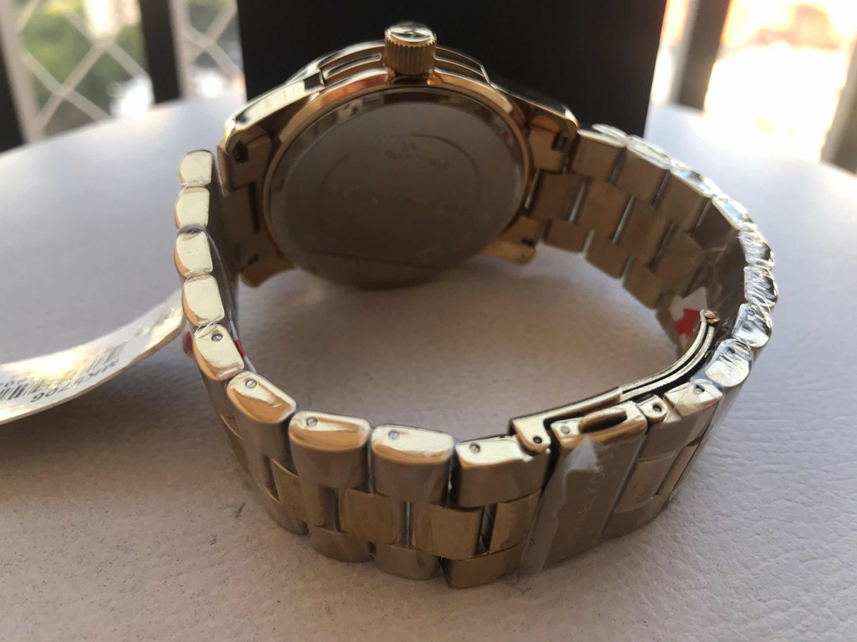 4470688675d relógio feminino mk dourado mk 5706. 4 Fotos