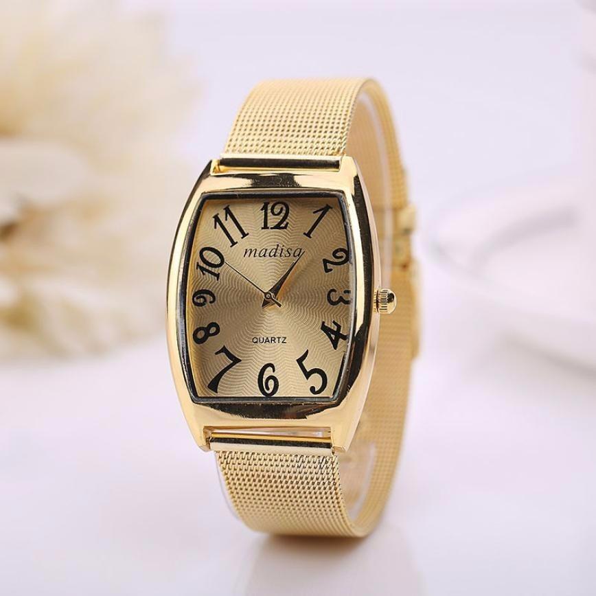 c97b13eb033 relógio feminino retangular dourado números grandes pretos. Carregando zoom.