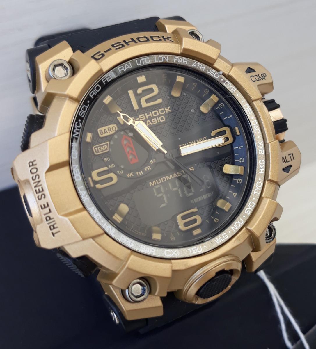3e9c01d7976 relógio g-shock caixa dourada e pulseira preta mund. Carregando zoom.
