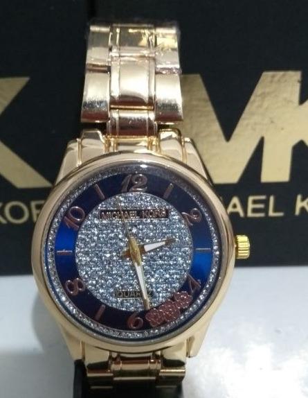 e87e17e344159 Relógio Michael Kors Feminino Dourado E Rose - Com Strass - R  57