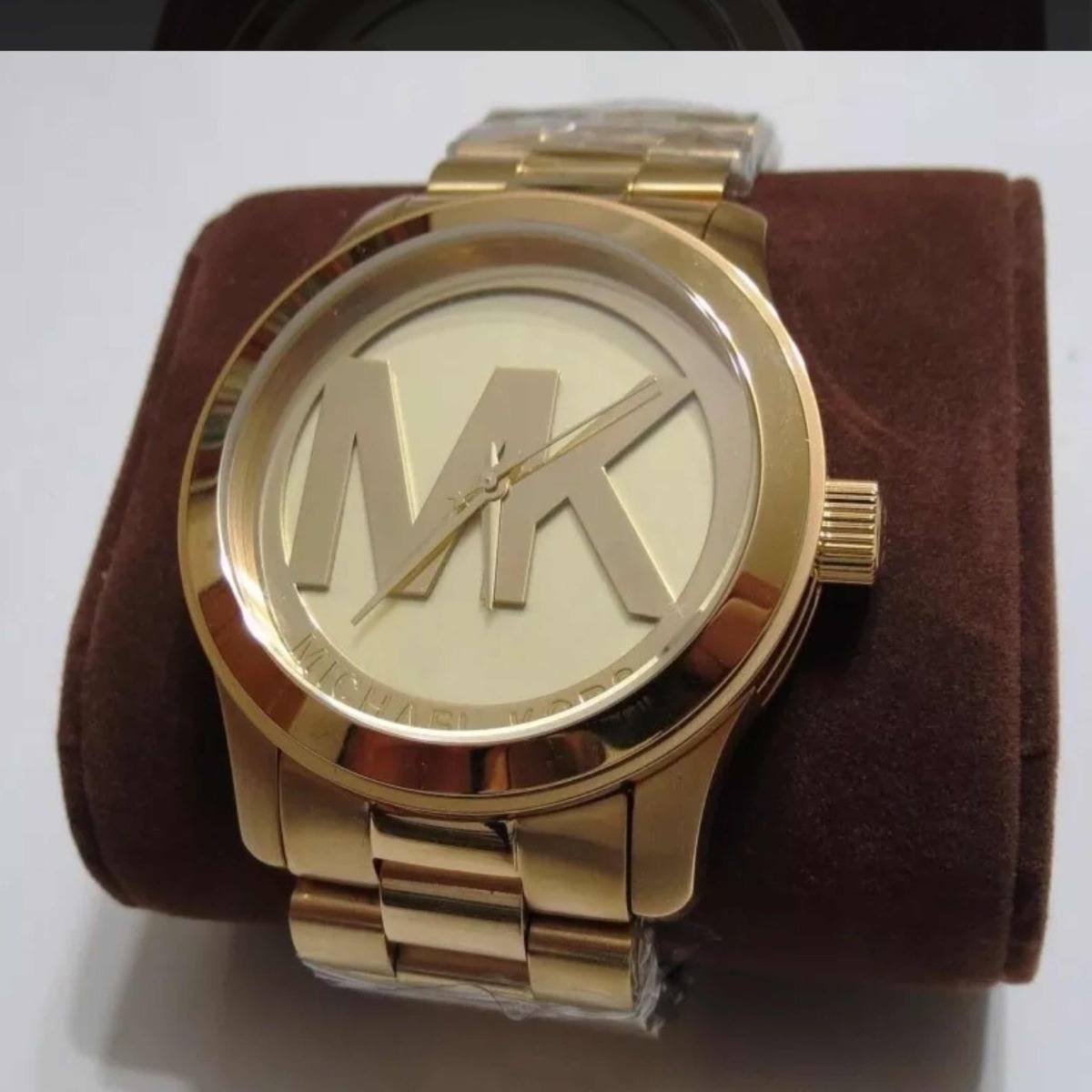 858ce0ef1c4d3 relógio michael kors feminino logo mk dourado. Carregando zoom.