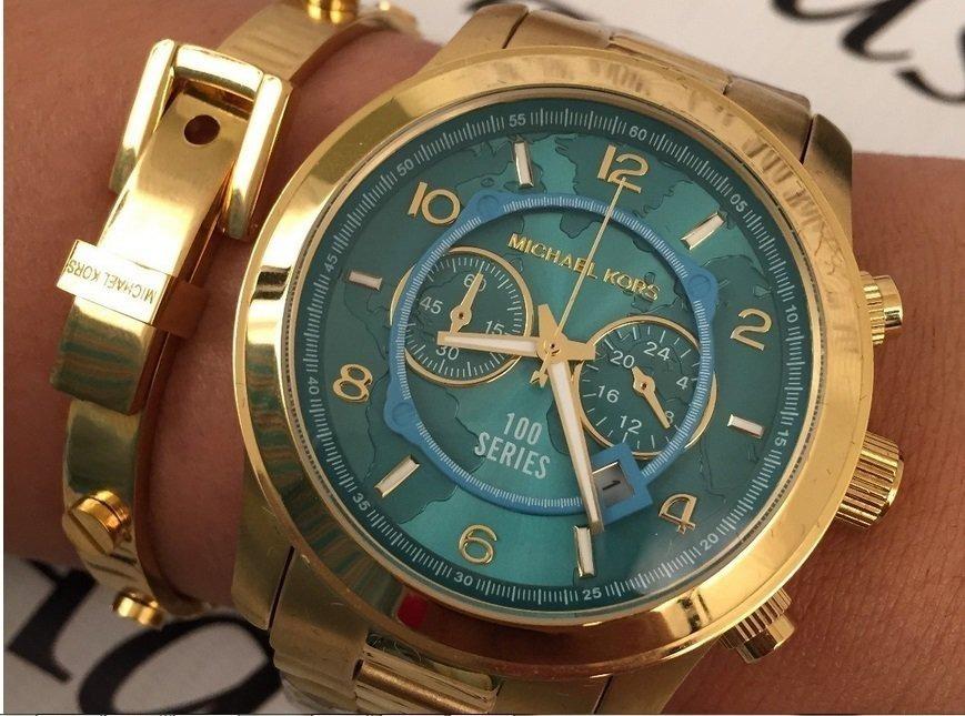 ed260bc9cef relógio michael kors mk8315 mapa dourado com turquesa 12x. Carregando zoom.