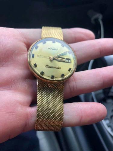 relógio mido ocean star chronometer em ouro maciço 750