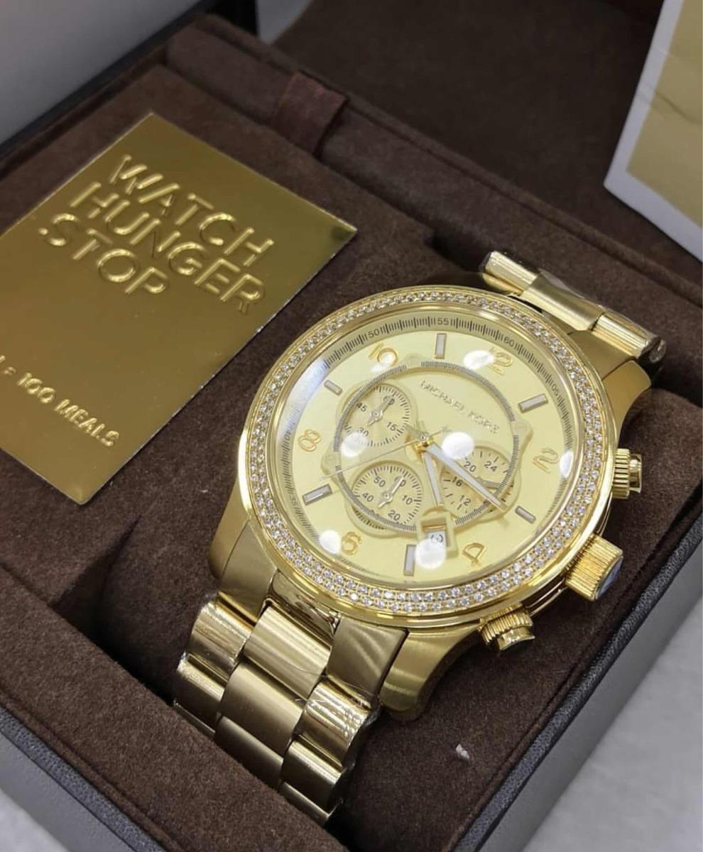 Relógio Mk 5575 Dourado Bezel Com Pedras - R  600,00 em Mercado Livre 19bb063e17