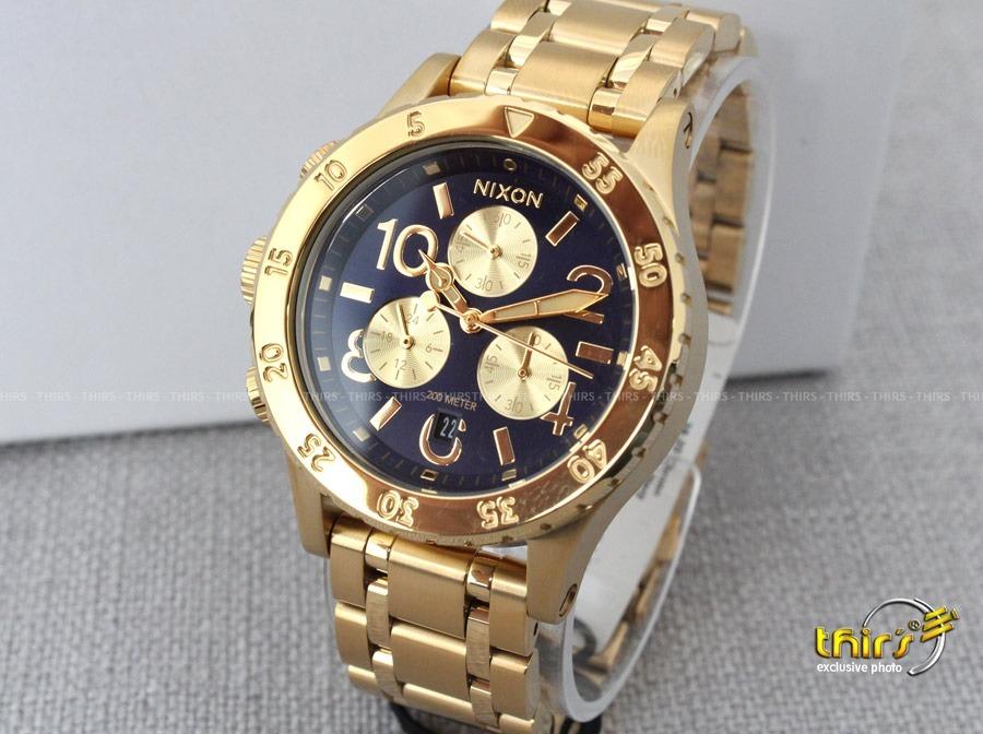 9c72cd695e3 Relogio Nixon 38-20 A404 - Feminino Gold Blue Original Thirs - R ...