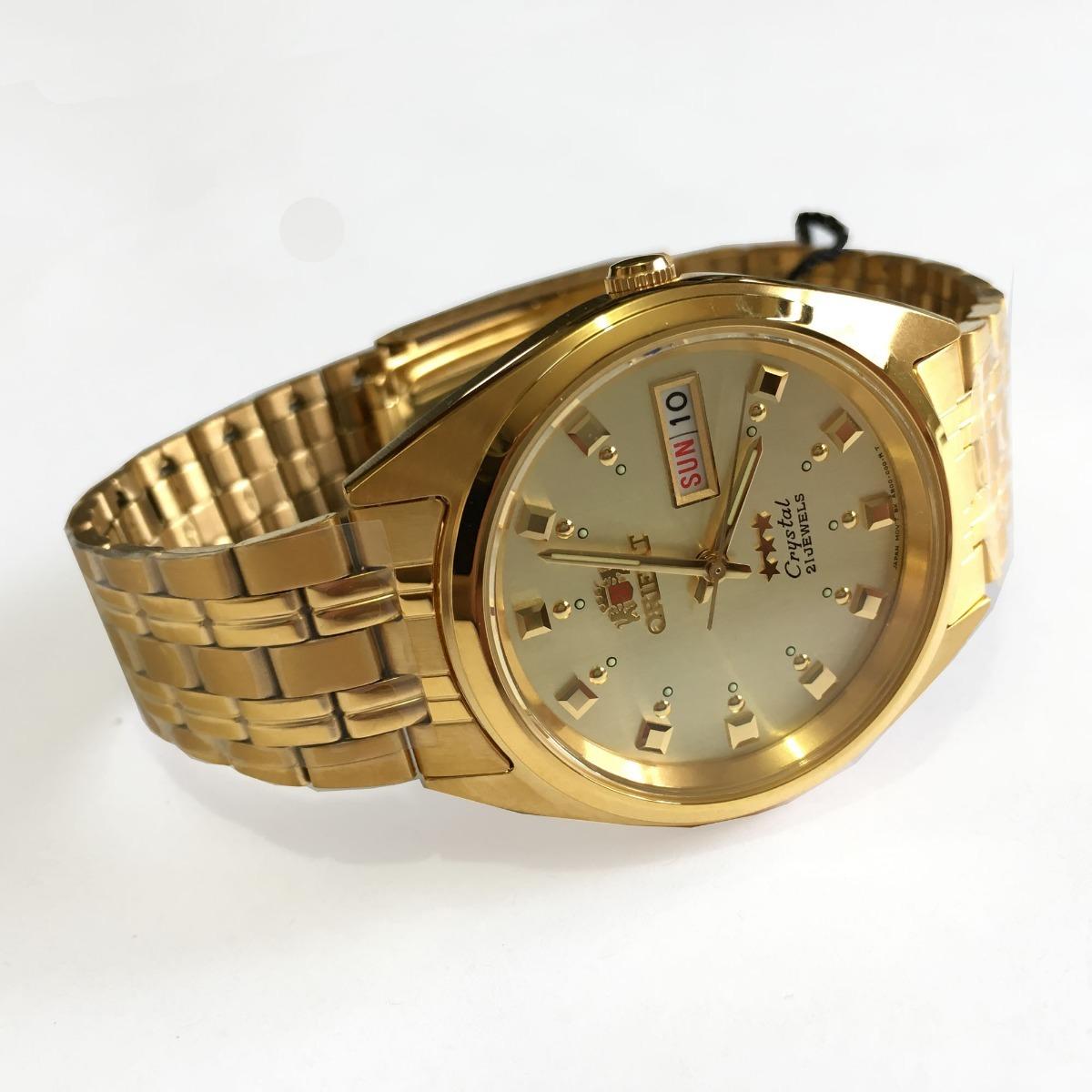 e7b9239b856 relógio orient automatico masculino dourado original c caixa. Carregando  zoom.