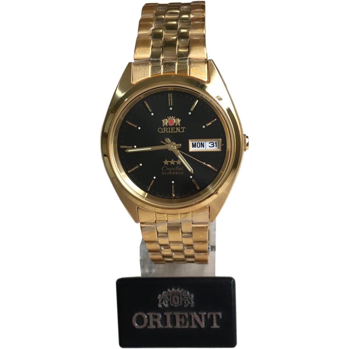 54dda9af60c relógio orient dourado fundo preto automático original c cx. Carregando  zoom.