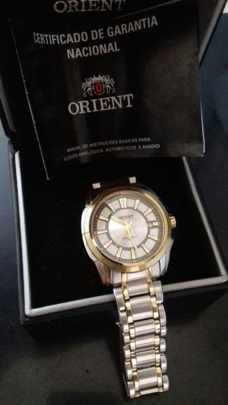 7e4101a56b3 relógio orient prata detalhes dourado 100% original. Carregando zoom.