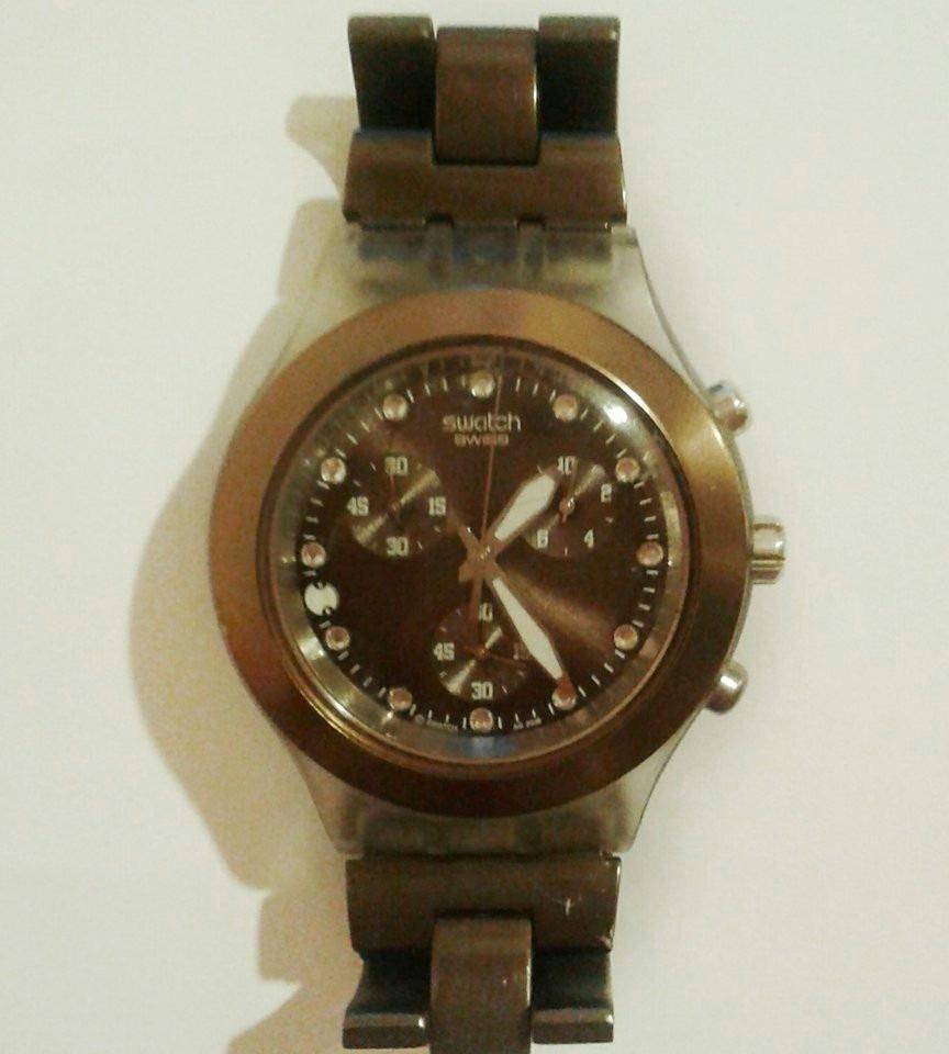 3318623ca2d relógio original swatch marrom. Carregando zoom.